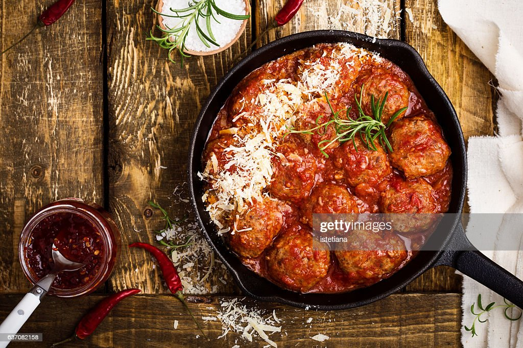 Meatballs in sour tomato sauce with grated parmesan cheese on top : Stock Photo