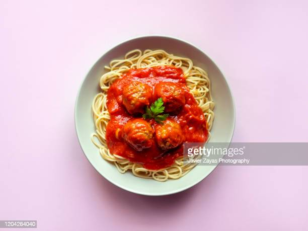 meatballs in spaghetti - noodles stock pictures, royalty-free photos & images