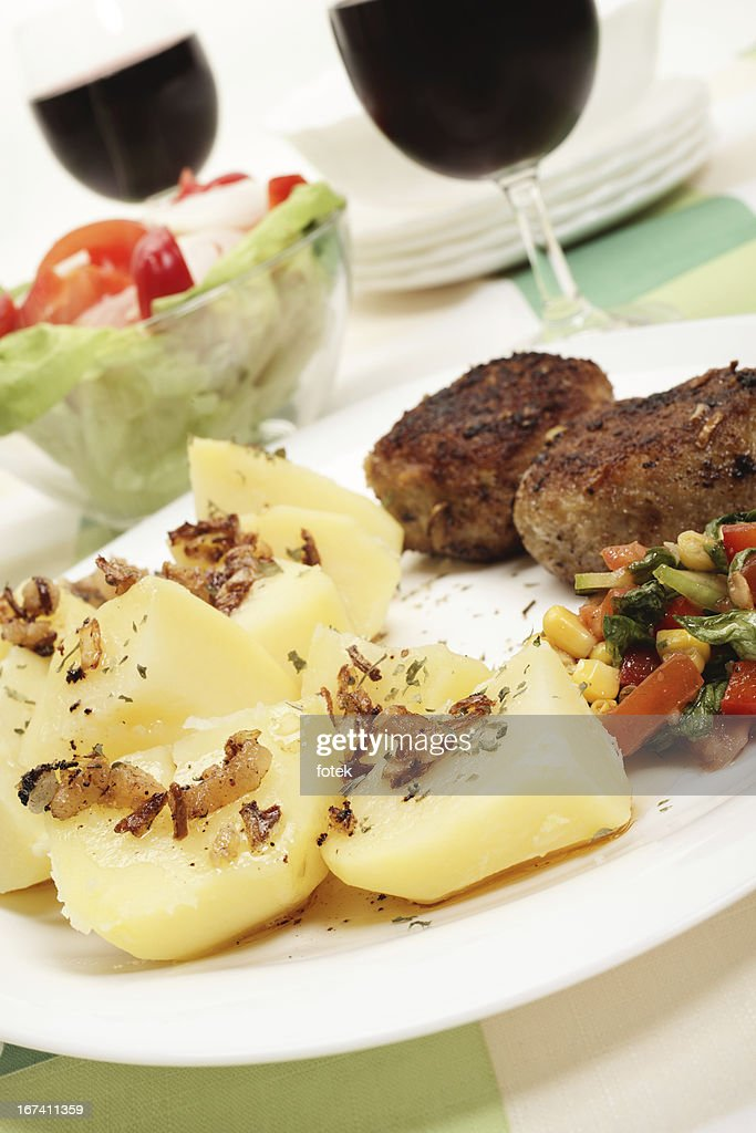 Meatballs with boiled potatoes : Stock Photo