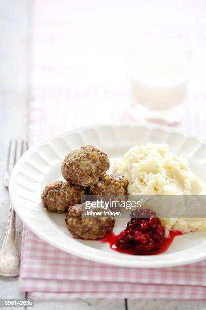Meatballs with mashed potatoes and cranberry sauce