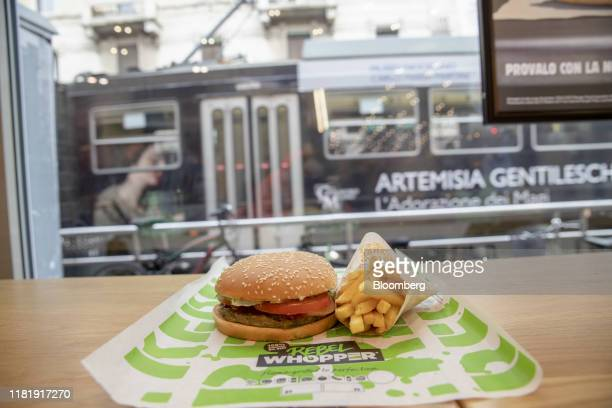 A meatfree Rebel Whooper burger sits on a counter next to a portion of fries at a Burger King Holdings Inc fastfood restaurant in Milan Italy on...