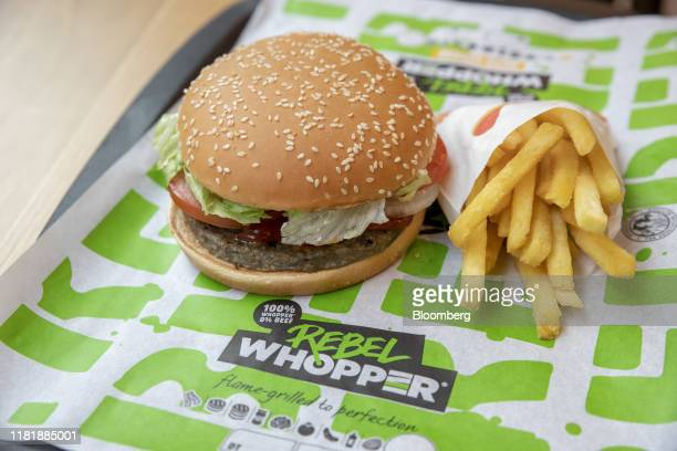 A meatfree Rebel Whooper sits on a tray next to a portion of fries at a Burger King Holdings Inc fastfood restaurant in Milan Italy on Tuesday Nov 12...