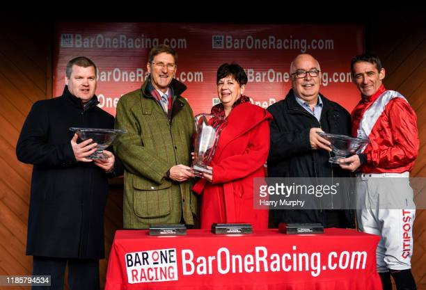 Meath Ireland 1 December 2019 Trainer Gordon Eliott representative owner Chris Hitchens and jockey Davy Russell after winning the BARONERACINGCOM...