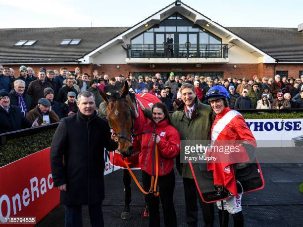Meath Ireland 1 December 2019 Trainer Gordon Eliott representative owner Chris Hitchens and jockey Davy Russell with Envoi Allen after winning the...