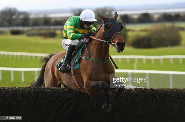Meath , Ireland - 13 March 2021; Any Second Now, with Mark Walsh up, jumps the last on their way to winning the Webster Cup Steeplechase at Navan...