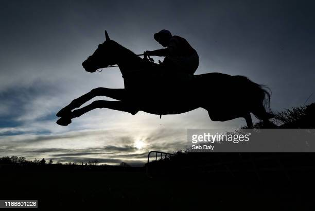Meath , Ireland - 15 December 2019; Blackbow, with Paul Townend up, jumps the third during the Irish Stallion Owners EBF Maiden Hurdle at Navan...