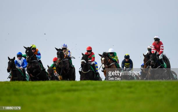 Meath Ireland 15 December 2019 Eventual winner Captain Guinness third left with Rachael Blackmore up jumps the first on their way to winning the...
