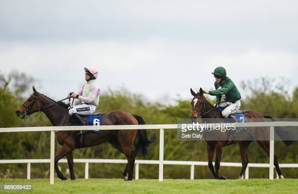 Meath Ireland 16 April 2017 David Mullins right congratulates his horse Augusta Kate after beating Let's Dance left with Ruby Walsh up to win the...