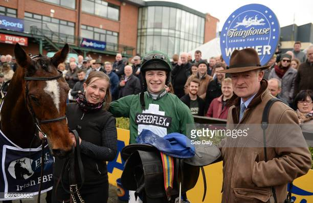 Meath Ireland 16 April 2017 Jockey David Mullins second left with trainer Willie Mullins right with Augusta Kate after winning the Irish Stallion...