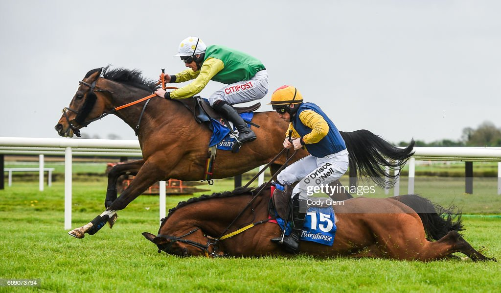 Meath , Ireland - 16 April 2017; Tudor City, with Davy Russell up, race ahead of Runforbob, with Sean Flanagan up, who fell over the last and did not finish, on their way to winning the Cusack Hotel Group Maiden Hurdle during the Fairyhouse Easter Festival at Fairyhouse Racecourse in Ratoath, Co Meath.