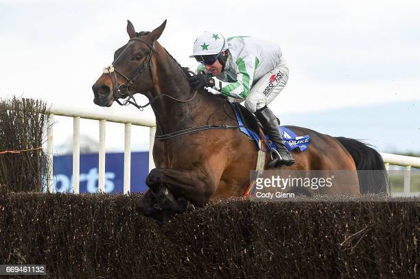 Meath Ireland 17 April 2017 Our Duke with Robbie Power up jump the last on their way to winning the Boylesports Irish Grand National Steeplechase...