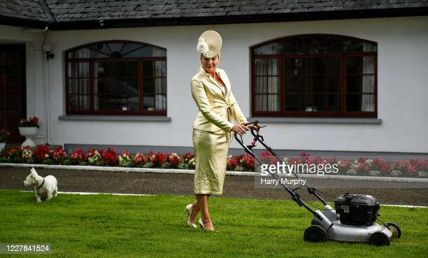 Meath Ireland 30 July 2020 Louise Allen from Slane in Meath cuts the grass in her outfit for the 2020 Galway Races Ladies Day which has now had to go...
