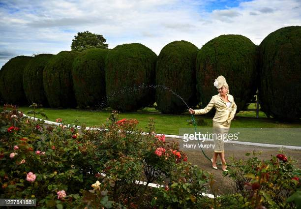Meath Ireland 30 July 2020 Louise Allen from Slane in Meath waters the roses in her outfit for the 2020 Galway Races Ladies Day which has now had to...