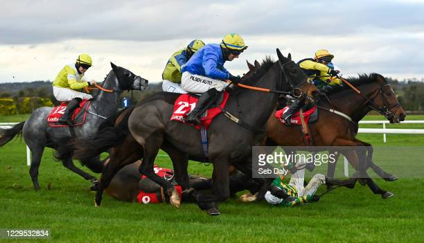 Meath , Ireland - 8 November 2020; Youngnedofthehill, near, with Conor McNamara up, races passed fallen jockey Mark Walsh, who was unseated from Pike...