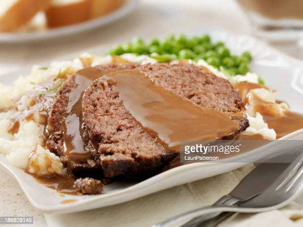meatloaf dinner - gravy stock photos and pictures