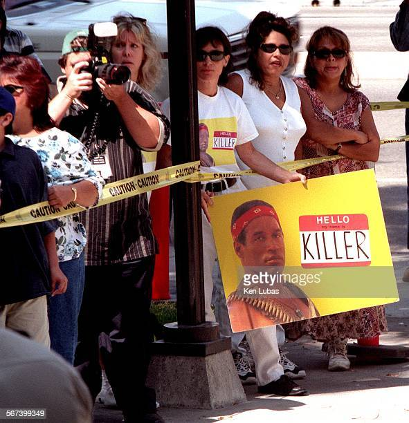 MEauctionlkl7/14––NORWALK––Auction of OJ Simpson's Brentwood house Monday morning in front of the Norwalk Courthouse wasn't without those still...