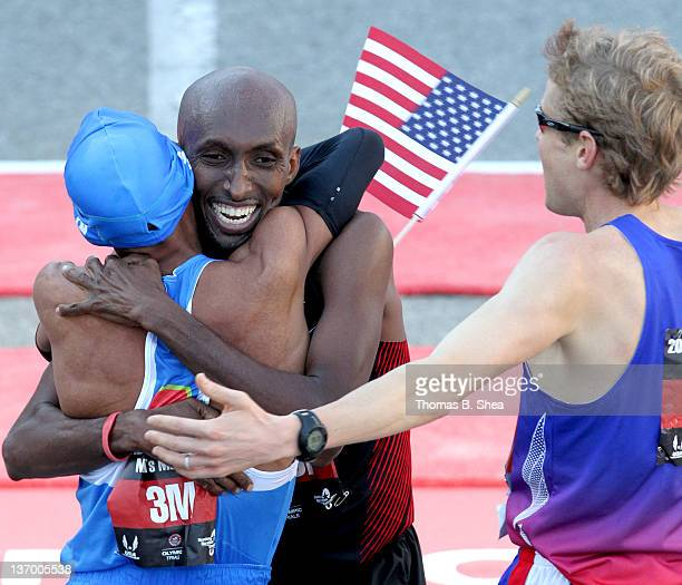 Meb Keflezighi Abdi Abdirahman and Ryan Hall celebrate after they finish the US Marathon Olympic Trials January 14 2012 in Houston Texas