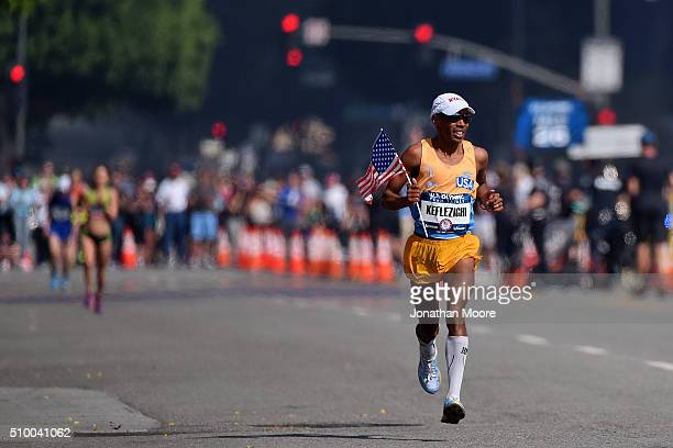 Meb Keflezighi celebrates as he approaches the finish line to take second place during the US Olympic Marathon Team Trials on February 13 2016 in Los...