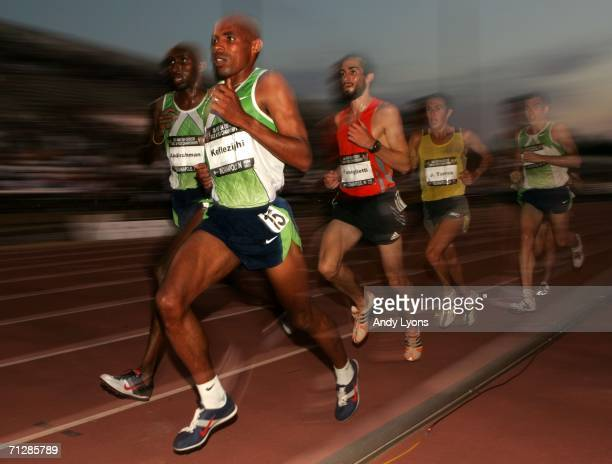 Meb Keflezighi leads Abdi Abdirahman and the pack during men's 10000 meter run on day two of the ATT USA Outdoor Track and Field Championships at...