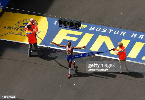 Meb Keflezighi of the United States crosses the finish line in first place to win the 2014 BAA Boston Marathon on April 21 2014 in Boston...