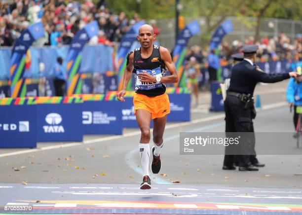 Meb Keflezighi of the United States crosses the finish line of his last New York City Marathon during the Professional Men's Division during the 2017...