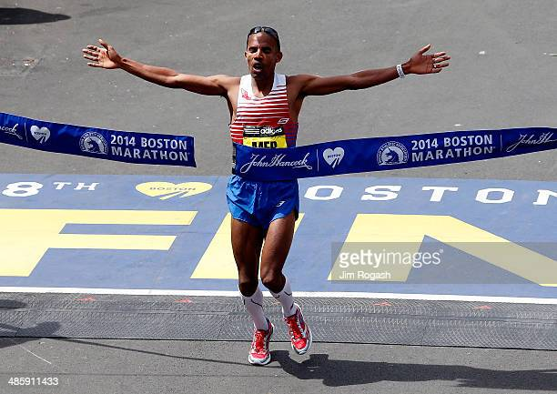 Meb Keflezighi of the United States crosses the finish line to win the 118th Boston Marathon on April 21 2014 in Boston Massachusetts