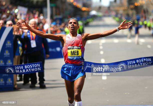 Meb Keflezighi of the United States crosses the finish line to win first place in the men's race of the 118th Boston Marathon on Monday April 21 2014