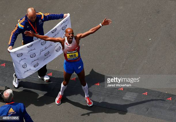 Meb Keflezighi of the United States reacts after coming in first place in the 2014 BAA Boston Marathon on April 21 2014 in Boston Massachusetts Meb...