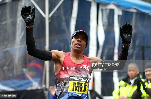 Meb Keflezighi of the United States reacts after crossing the finish line during the 119th Boston Marathon on April 20 2015 in Boston Massachusetts