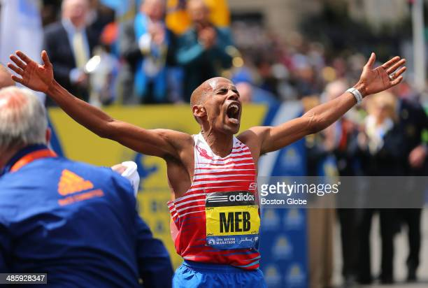Meb Keflezighi, of the United States, reacts after crossing the finish line to win first place in the men's race of the 118th Boston Marathon on...
