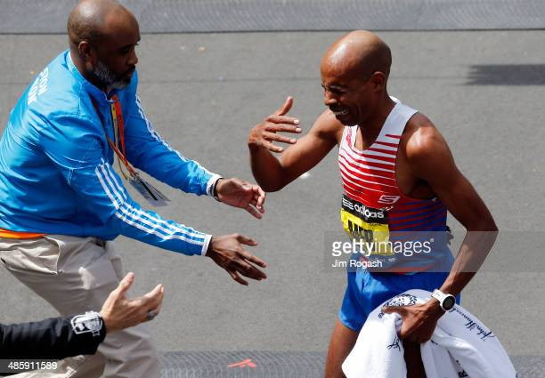 Meb Keflezighi of the United States reacts after winning the 118th Boston Marathon on April 21 2014 in Boston Massachusetts