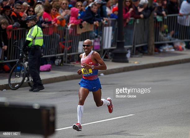 Meb Keflezighi, of the United States, runs down the home stretch on Boylston Street to finish first in the men's division of the 118th Boston...