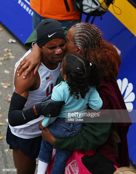 Meb Keflezighi of the USA celebrates with his family after winning the 40th mens ING New York City Marathon on November 1 2009 in New York City