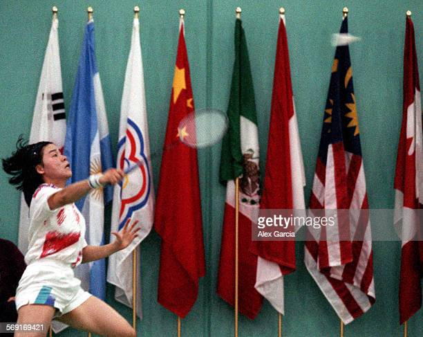 MEbadmintonflags0910AAG–––Takako Ida of Japan swats at the shuttlecock during the Women's Singles competition of the Hong Ta Shan US Open Badminton...