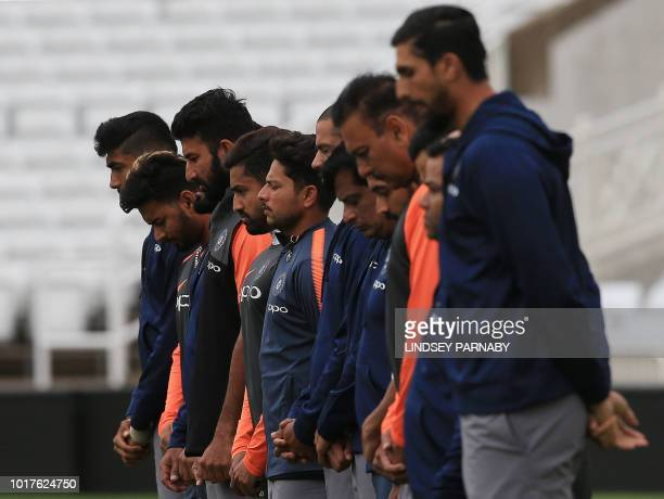 Mebers of India's cricket team pay their respects to former captain Ajit Wadekar who died on August 15 during a practice session ahead of the third...