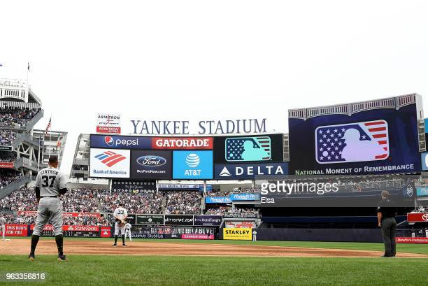Mebers of the Houston Astros and the New York Yankees stand for a moment of silence in the sixth inning at Yankee Stadium on May 28 2018 in the Bronx...