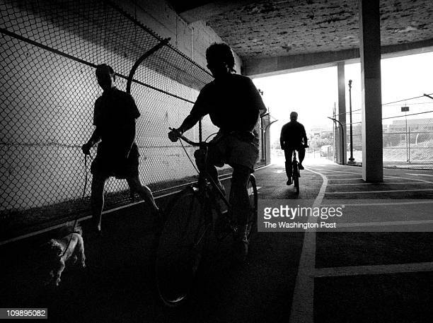 Dudley M Brooks BACKGROUND New bike and jogging tunnel in Bethesda Md Joggers bikers and dog walkers enjoy a brand new tunnel for their use in...