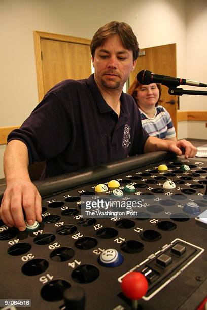 May 24 2007 CREDIT James M Thresher / The Washington Post Bingo at Annandale Fire Station Number caller Steve Menger and Brenda Rosamond watching the...