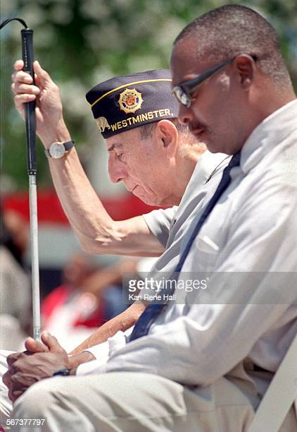 Blind.bowed4.KH.5/21/96.Manuel Quintana, a WWII veteran from Orange holding his cane and Larry Ervin, a Vietnam veteran from Rialto bow their heads...