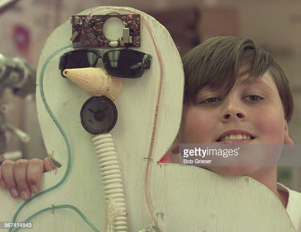 MEBodiesRyan1BG6May97––Ryan Allcom with the head of his trash body using a phone mother board for the brain sunglasses ice cream cone for the nose...