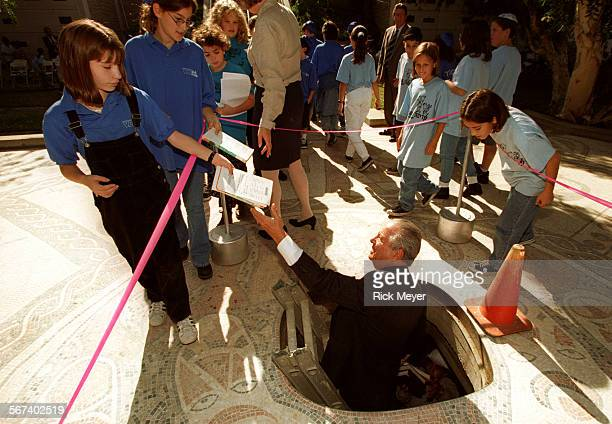 MEBooks#41112RM/3 Fred Ellsberg an official at Mt Sinai Memorial Park accepts sacred books from students of Jewish day schools Please read other...
