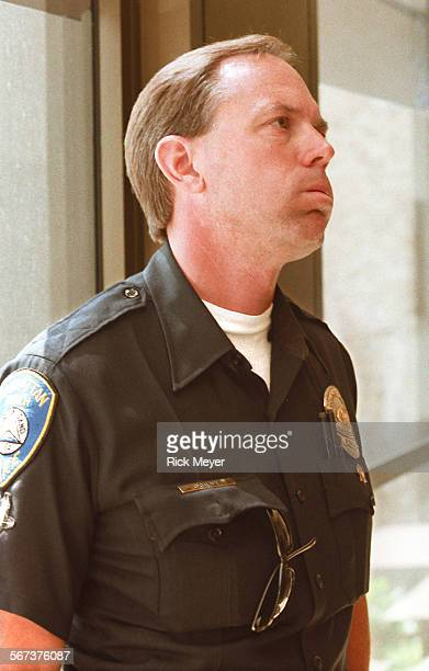 MEBrady#10805RM/a Manhattan Beach police officer Neal O'Gilvy reacts to seeing the accused killer of his partner Martin Ganz in court this morning...