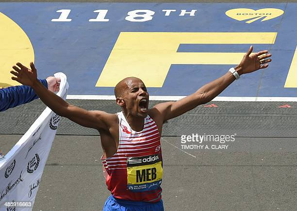 "Mebrahtom ""Meb"" Keflezighi of the US crosses the finish line to win the Men's division of the 118th Boston Marathon in Boston, Massachusetts April..."