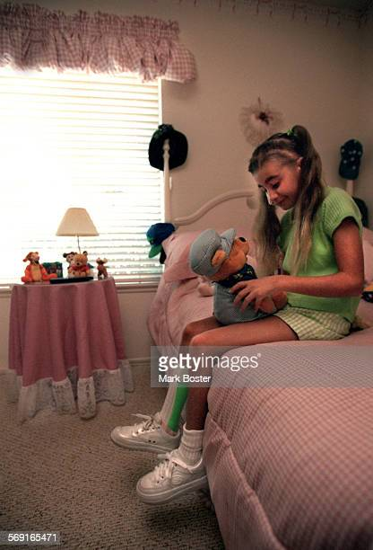 MEBrainBed082997MB–––Jennifer Cottini sat on the edge of her bed holding her favorite stuffed animal– Winnie The Pooh Since she suffered a stroke...