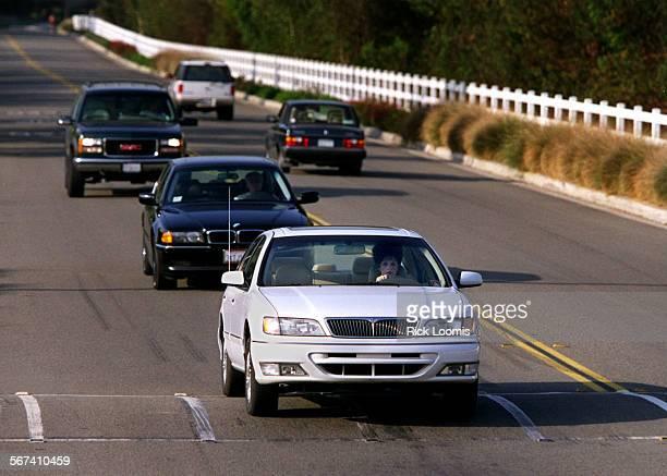 MEbumps1001RL––Coto de Caza––I line of cars slows down to face a large speed bump on Vista del Verde inside Coto de Caza