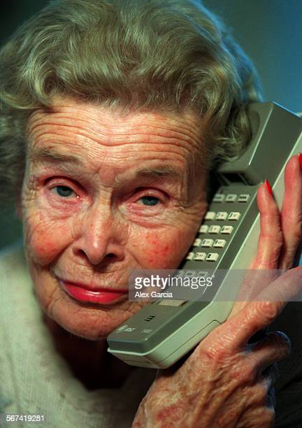 Caller.closeup.1227.AAG––Grace Henderson makes telephone calls on a daily basis to elderly citizens to make sure they are O.K. She is standing behind...