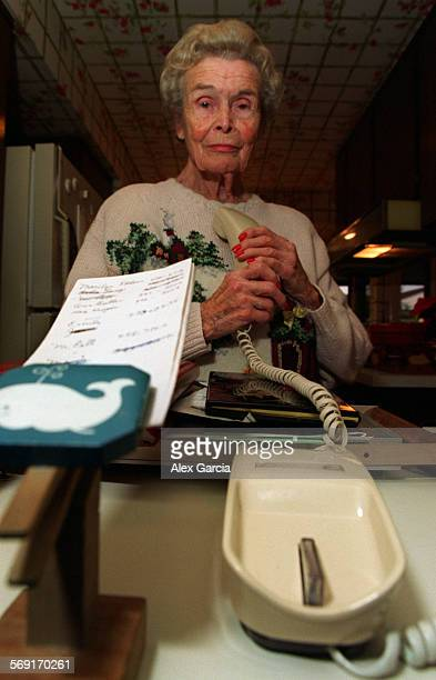 Caller.vertical.1227.AAG––Grace Henderson makes telephone calls on a daily basis to elderly citizens to make sure they are O.K. She is standing...