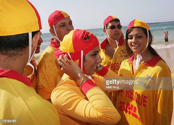 Mecca Laa Laa adjusts her 'Burqini' on her first surf lifesaving patrol at North Cronulla Beach February 4, 2007 in Sydney, Australia. The red and...