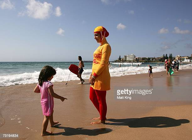 Mecca Laa Laa talks to a young girl whilst wearing a 'Burqini' on her first surf lifesaving patrol at North Cronulla Beach February 4 2007 in Sydney...