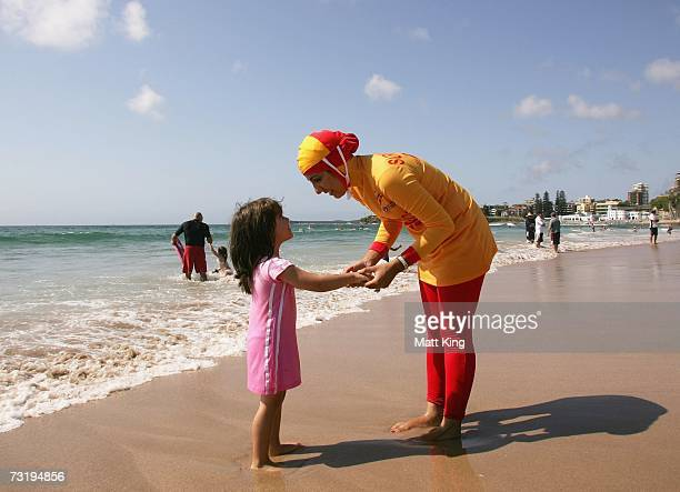 Mecca Laa Laa talks to a young girl whilst wearing a 'Burqini' on her first surf lifesaving patrol at North Cronulla Beach February 4, 2007 in...